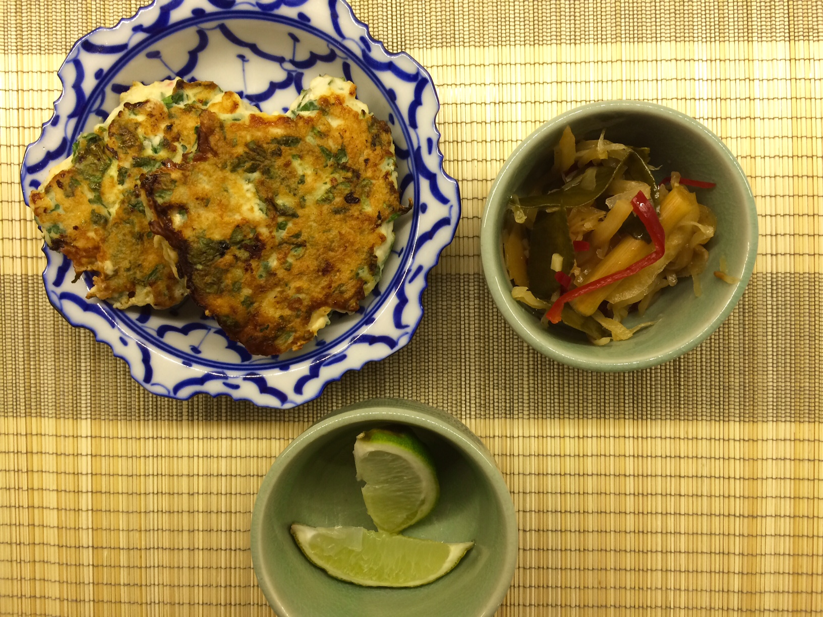 Thai chicken cakes served with lime and Thai pickles